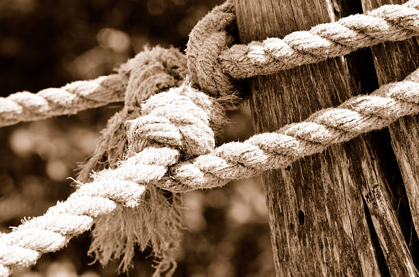Rope on wooden post stock photo