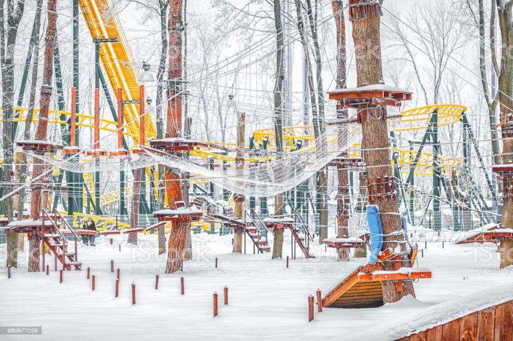 Rope park on trees. Snowy winter scene. stock photo