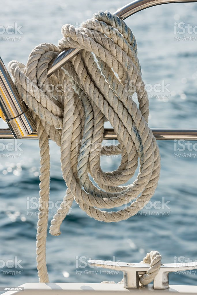 Rope tied around a rail on a yacht stock photo
