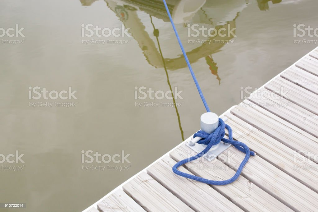 rope tied at berth for boats stock photo