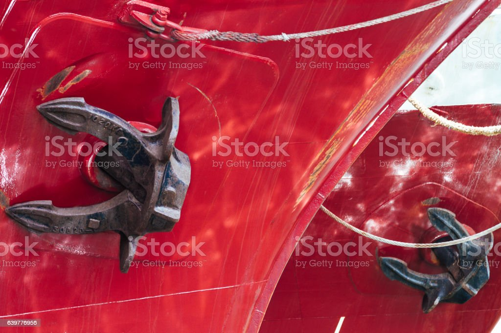 Rope tied to the hull with anchor of a boat stock photo