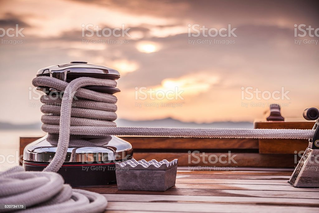 Rope Winch on Sailing Yacht Sunset stock photo
