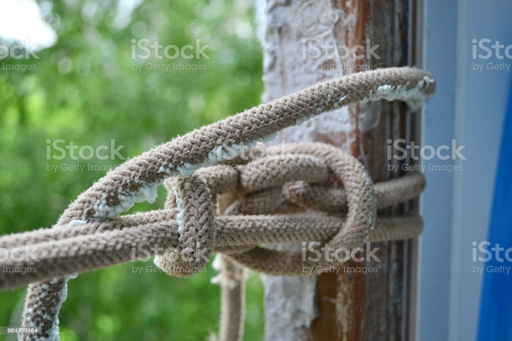 Rope with a knot royalty-free stock photo