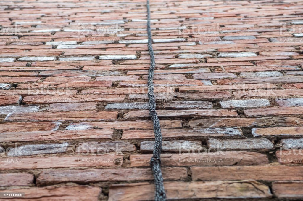 Rope with red bricks royalty-free stock photo