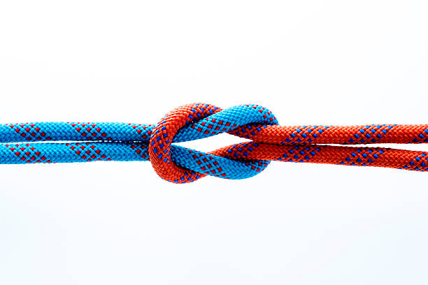 rope with reef knot isolated on white background - symmetrie stock-fotos und bilder