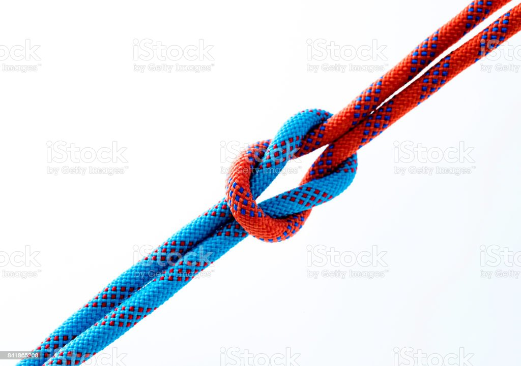 Rope with reef knot isolated on white background stock photo