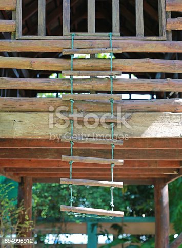 istock Rope wooden ladder at playground. 854998912