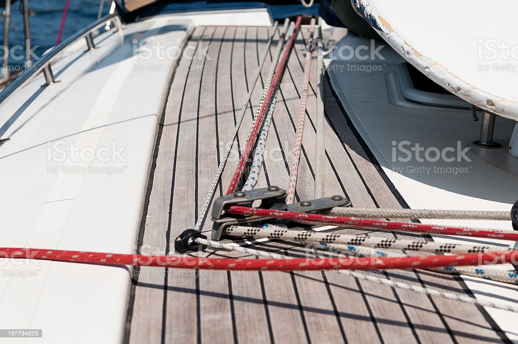 Ropes and stoppers on a sailing boat deck stock photo