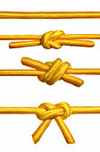 Closeup shots of a rope with a knot. Isolated white background.