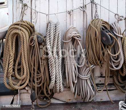 Skeins of rope strung along a wire on an old boat moored at Nyhavn, the old harbour in Copenhagen, capital of Denmark.