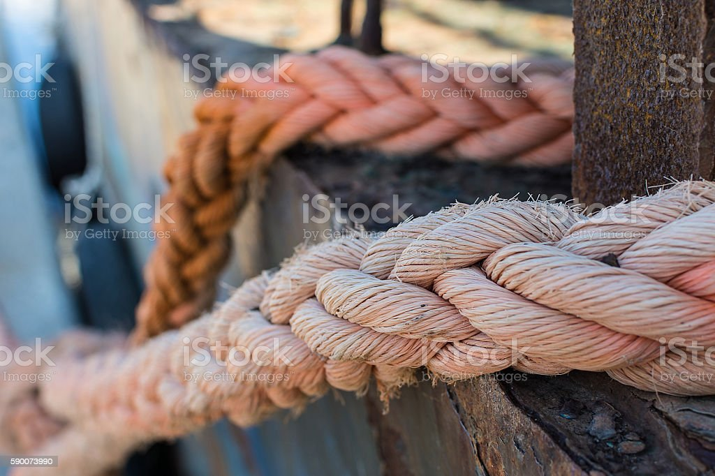 Ropes on Old Rusty Ship Closeup. Old Frayed Boat Rope. stock photo