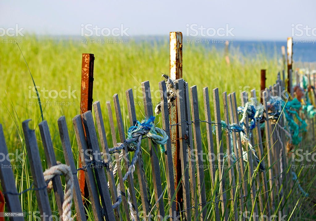 Ropes Tied on a Beach Fence stock photo