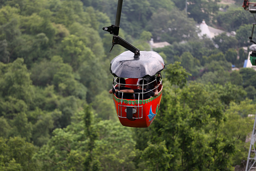 """The Udan Khatola is one of the major attractions of the place and catches the attention of people from all over. It is a ropeway which is used as a mode of transport to reach the hill top temples of Haridwar. There are two hilltop temples near Haridwar, Mansa Devi and Chandi Devi, both have ropeways to reach the temples comfortably. The ropeway is quite popular by the name of """"ropeway to the Gods"""" and takes 5 minutes to reach the hill top."""