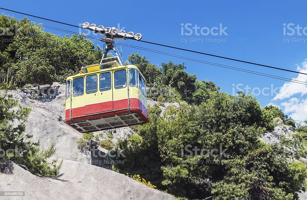Ropeway leading into the mountains stock photo