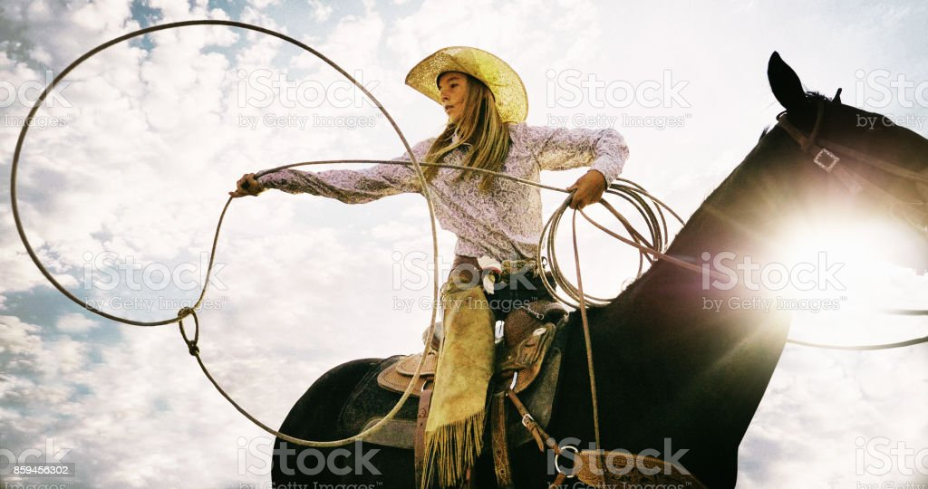 Roping Cowgirl stock photo