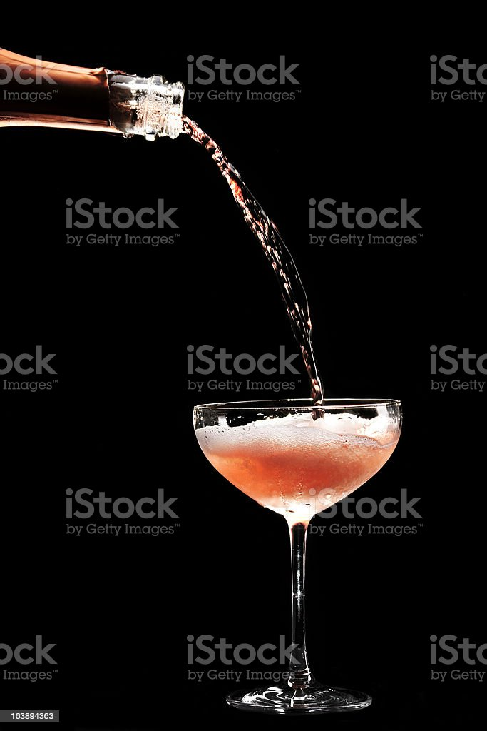 Rosé Champagne being filled in coupe glass stock photo