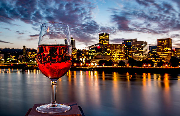 Rosé Wine Glass Inverted Image Riverfront Skyline Downtown Portland Oregon stock photo