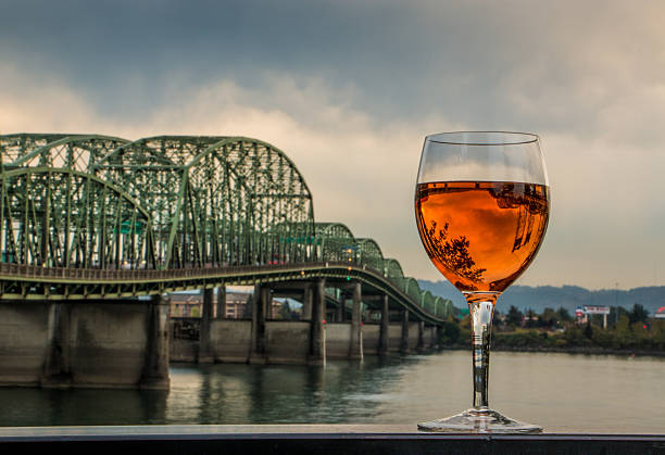 Rosé Wine Glass Inverting Interstate Bridge Columbia River Washington Oregon stock photo