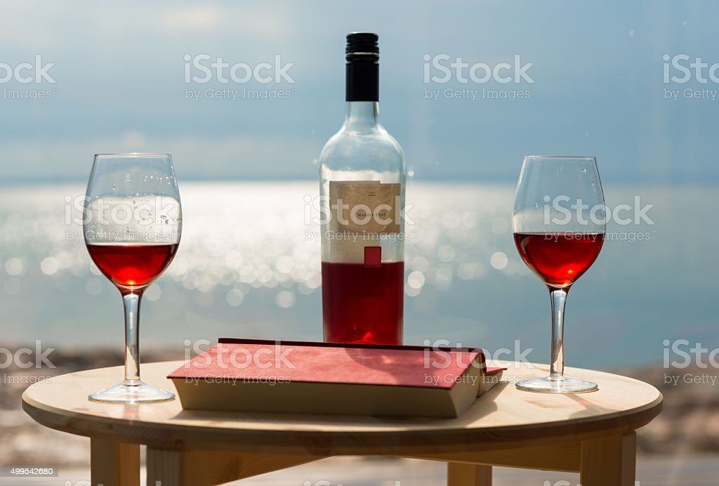 Rosé wine glasses and bottle on summer day stock photo