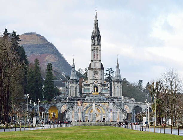 Rosary Basilica The Basilica of our Lady of the Rosary is a Roman Catholic church and minor basilica in Lourdes. Tourists and believers are in front of the Rosary basilica. shrine stock pictures, royalty-free photos & images