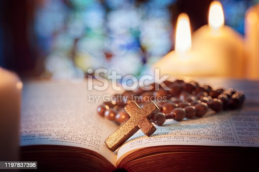 istock Rosary beads and crucifix cross on holy bible 1197837398