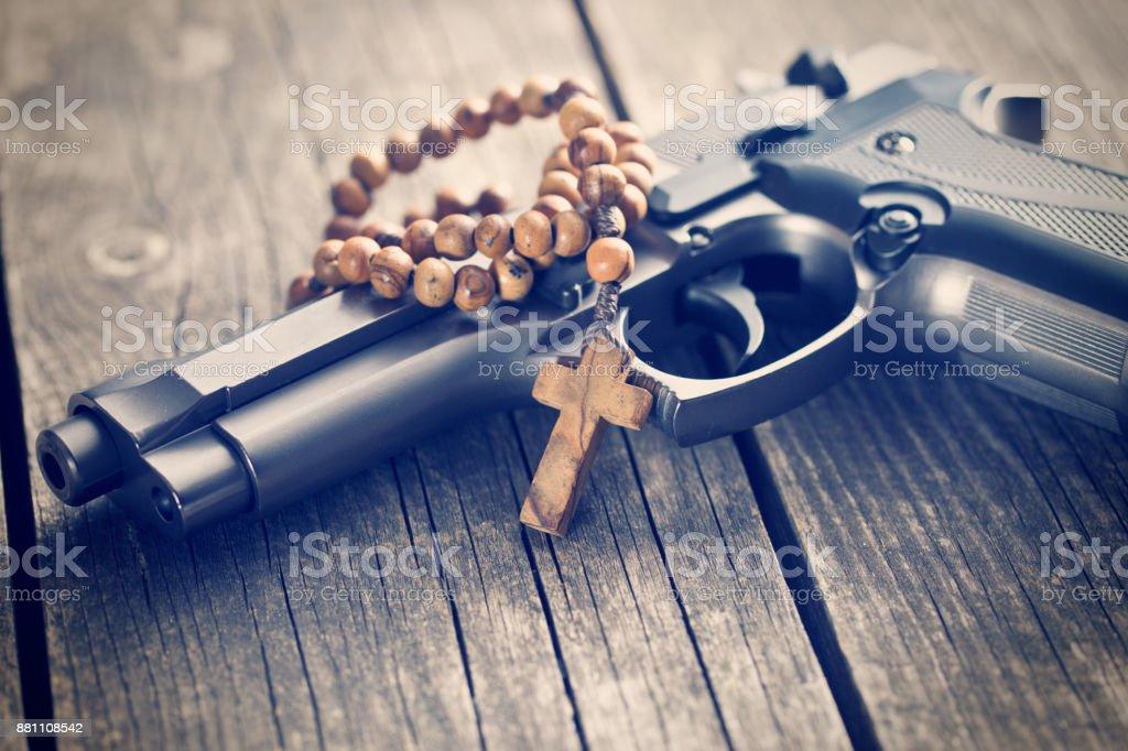 rosary beads and gun stock photo