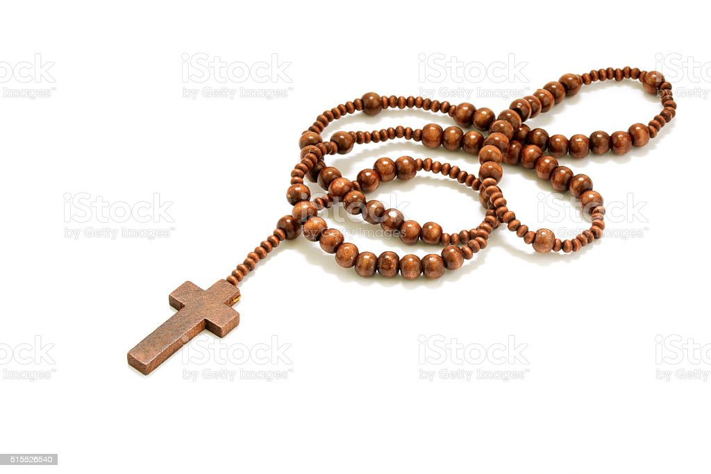 rosary beads with cross made of wood isolated on white stock photo