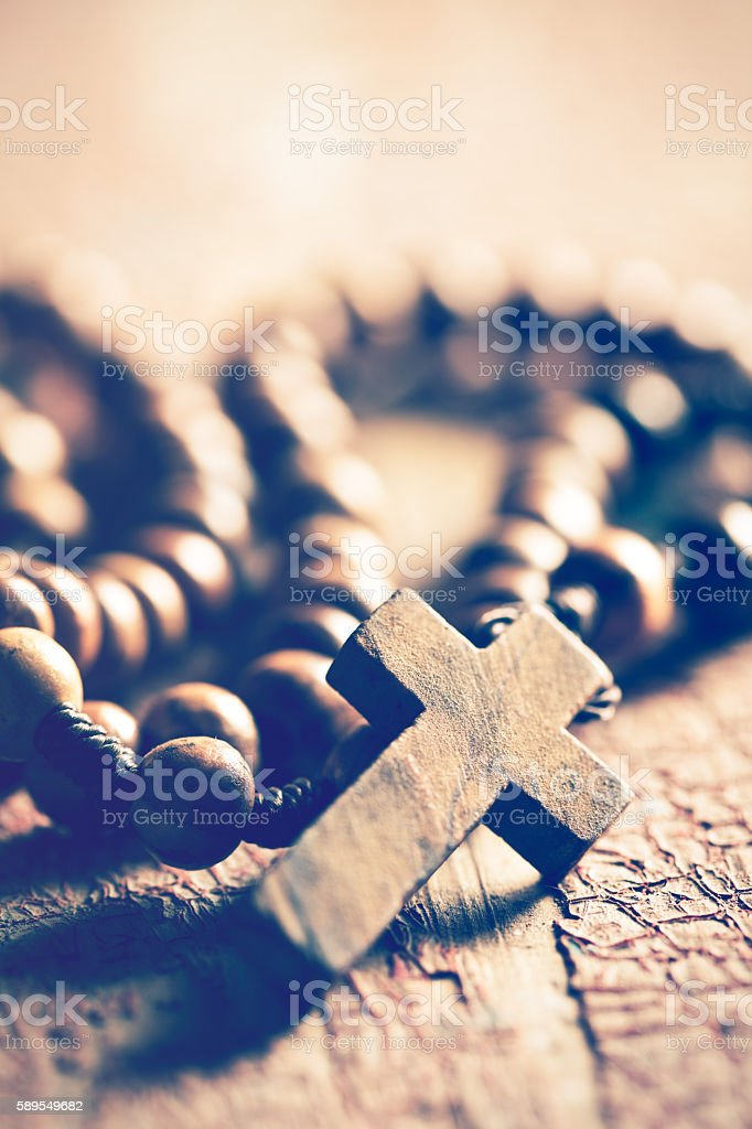 rosary on old wooden table stock photo