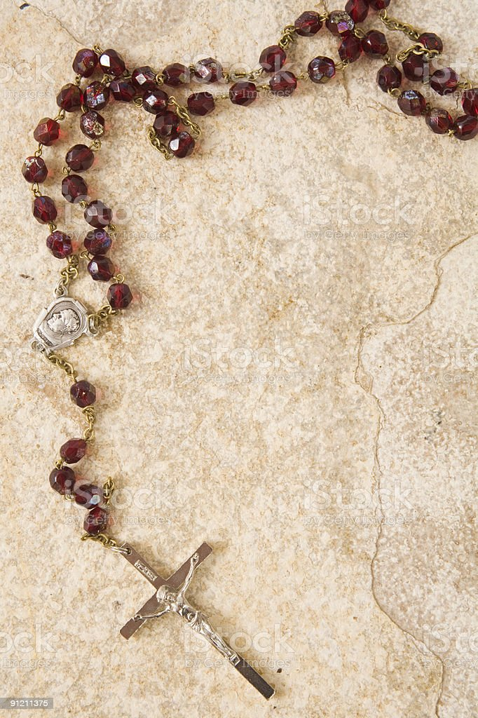 Rosary on stone with copy space stock photo
