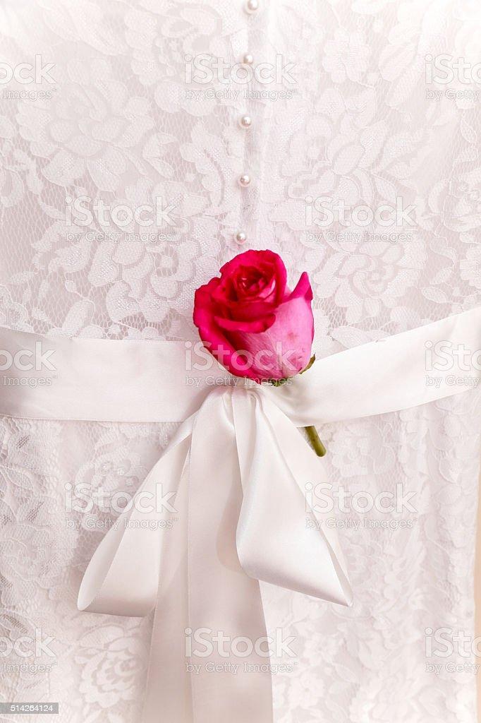 rose and wedding dress stock photo