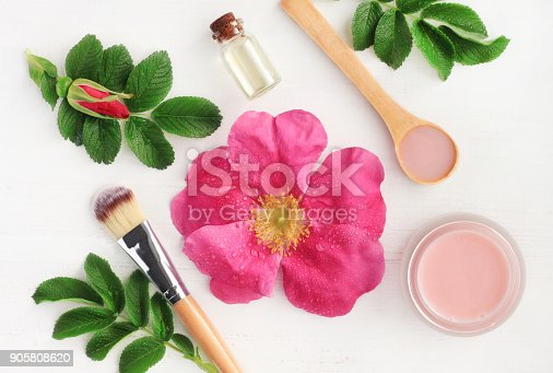 istock Rose aroma cosmetic products for natural beauty treatment. Fresh pink flower, green leaves, essential oils, skincare mask 905808620