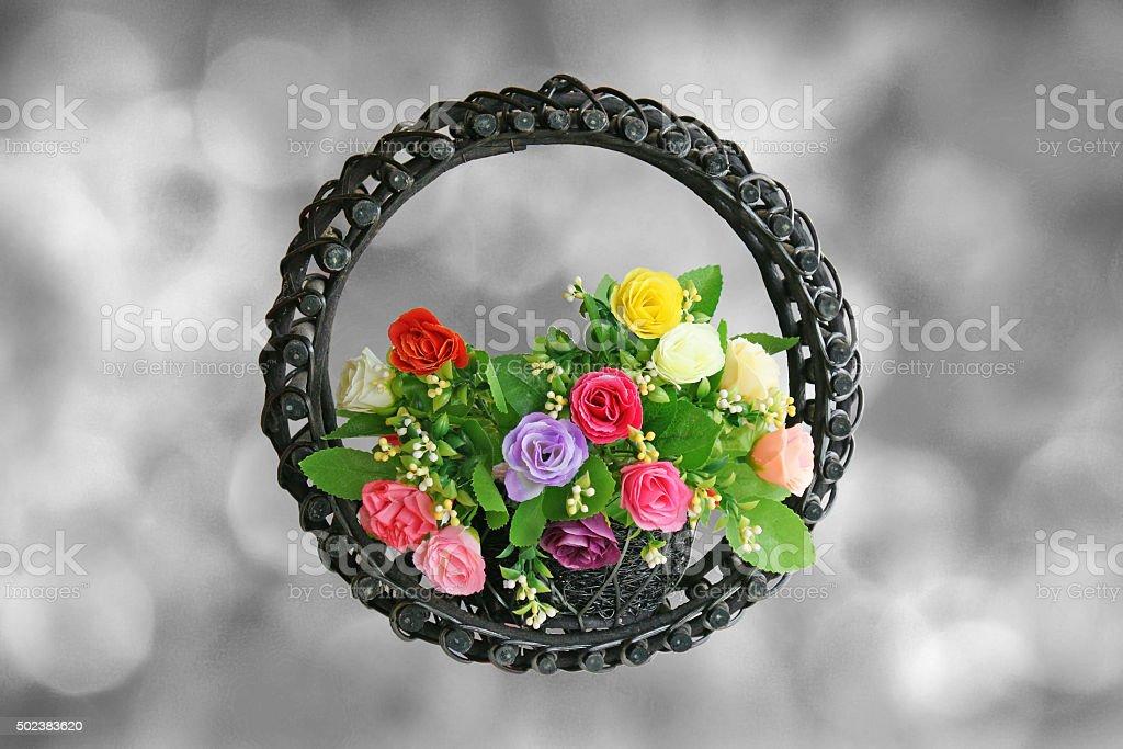 Rose Basket on black bokeh for 'Pray For Paris' concept stock photo
