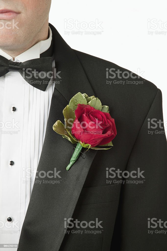 Rose boutonniere on lapel of man's tuxedo royalty-free stock photo
