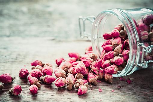 Rose buds in glass jar.