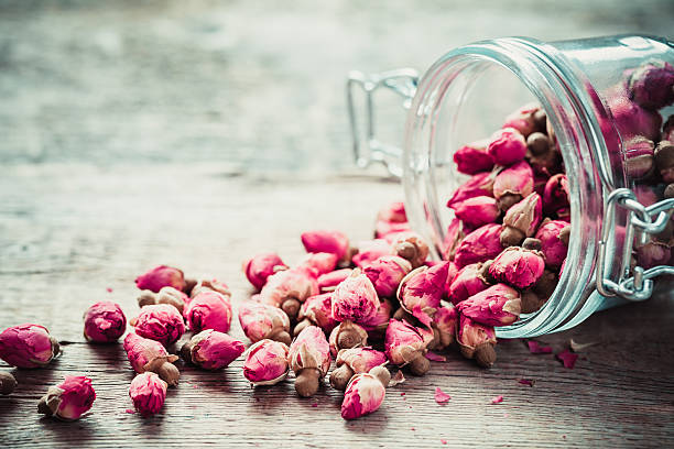 Rose buds in glass jar. Rose buds in glass jar. Selective focus. dried plant stock pictures, royalty-free photos & images