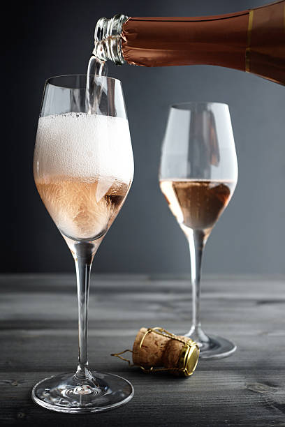 Rose Champagne being filled into Glass stock photo
