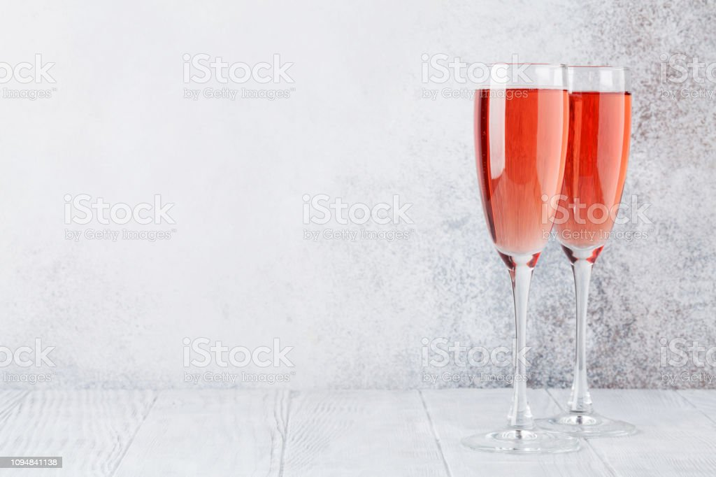 Rose champagne glasses stock photo
