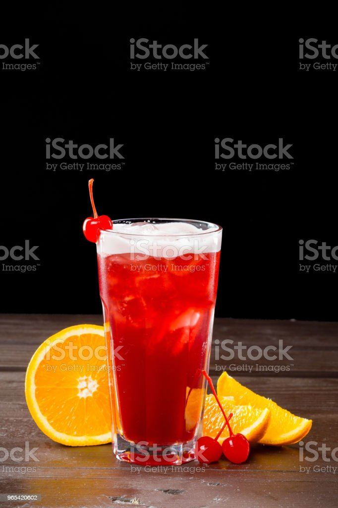 Rose coctail with ice on black background royalty-free stock photo