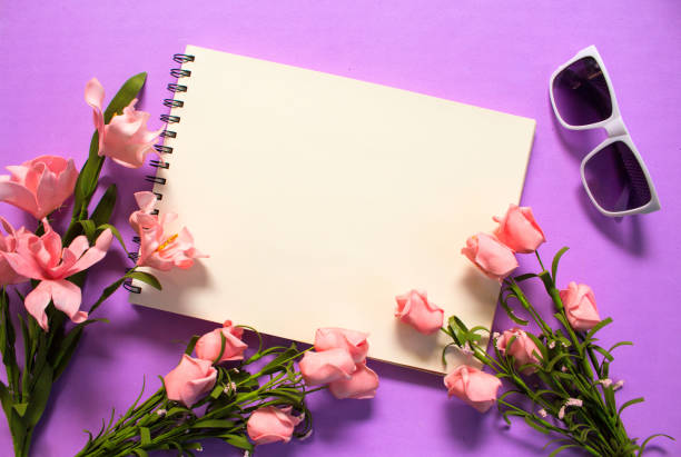 Rose flower frame of blank page on violet background. Romantic pink flower bouquet. stock photo