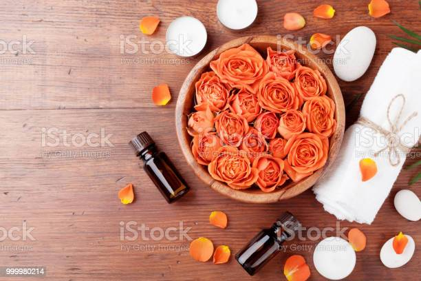Rose flower in bowl essential oil bottle towel and candles on wooden picture id999980214?b=1&k=6&m=999980214&s=612x612&h=jjxc3bqqxxldgylrttaruujuqwfcqm5utcvnctnvfua=