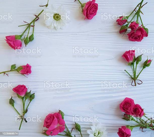 Rose flower pink on white wooden background frame picture id1028869574?b=1&k=6&m=1028869574&s=612x612&h=po8hq6sxxmme20ymbiyvwztvtuox9d3oolcsz7m7e9g=