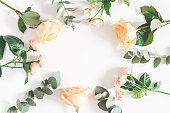istock Rose flowers and eucalyptus branches. Flat lay, top view 960815204