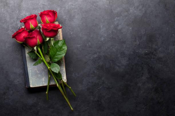 Rose flowers bouquet over old book picture id1127751690?b=1&k=6&m=1127751690&s=612x612&w=0&h=xj38duuxguxlq2jrb5xw29paz3ucoroyxatq8kvesg0=