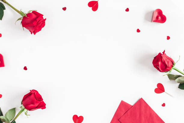Rose flowers, gifts, confetti. Valentines day. Flat lay, top view stock photo