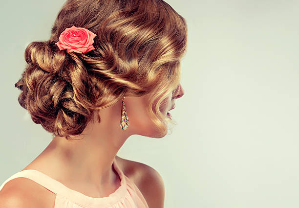 Rose Flowers In The Hair Example Of Wedding Hairstyle Stock Photo