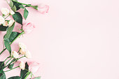 istock Rose flowers on pastel pink background. Flat lay, top view, copy space 1133778941