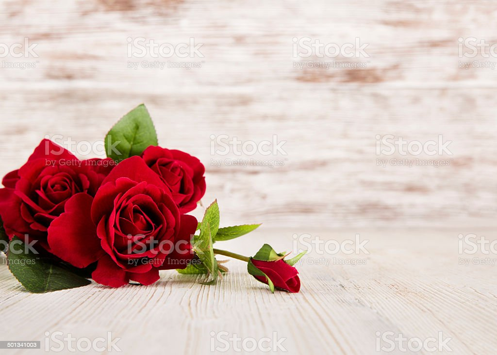 Rose flowers, red on wooden grunge background, floral card stock photo