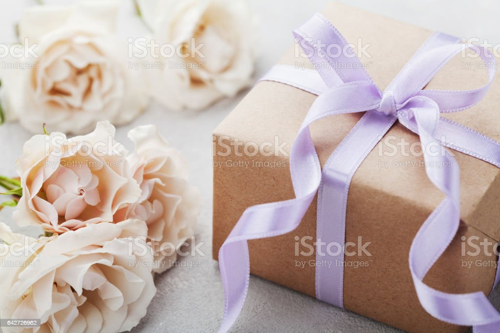 Rose flowers with gift for Birthday, Womens or Mothers Day. stock photo