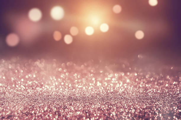 rose gold color abstract glitter texture background holidays - scintillante foto e immagini stock