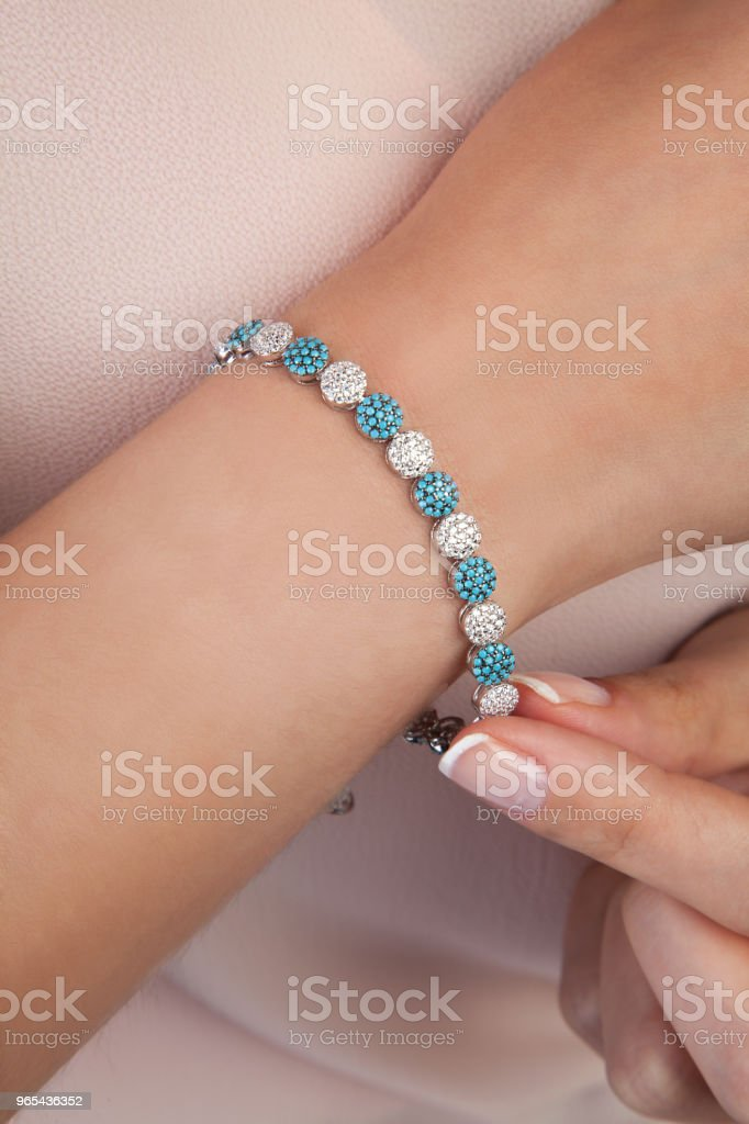 Rose Gold Diamond Bracelet with Blue Gem Stones royalty-free stock photo